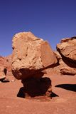 Balancing rock on tiny pedestal Royalty Free Stock Image