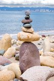 Balancing Rocks. Rocks stacked one one top of another on beach in Puerto Vallarta,  Banderas bay in background. This is an art form of Zen Stock Photos