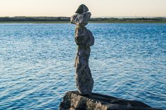 Balancing Rocks. Rocks delicately balanced against the incoming tide stock image
