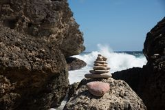 Balancing Rocks in front of ocean waves. Balancing Rocks stand with ocean waves crushing coastline in the background stock photography