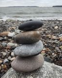 Balancing rocks. At Mills Point at Starboard Cove, Maine royalty free stock photos