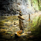 Balancing rocks tower for zen meditation practice. Amazing tropical rain forest landscape with lake and balancing rocks tower for zen meditation practice. Nature Stock Images