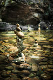 Balancing rocks tower for zen meditation practice. Amazing tropical rain forest landscape with lake and balancing rocks tower for zen meditation practice. Nature Stock Photography
