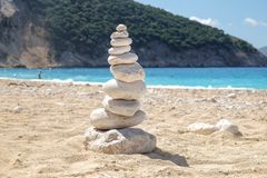 Balancing several of stones on the seashore beach. Zen like chill feel Stock Images