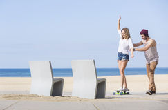 Balancing on a skateboard Royalty Free Stock Image