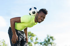 Balancing soccer ball. Smiling soccer player balancing ball on his neck Stock Photo