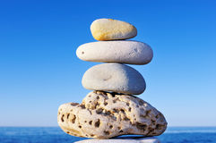 Balancing of Stack. Balancing several cobble-stones on each other on the shore Stock Photo