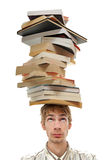 Balancing Stack of Books on Head Royalty Free Stock Image