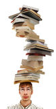 Balancing a Stack of Books on Head Stock Photo