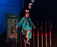 Balancing a stack of bowls on the head-Acrobatic showBaixi Dream Night Royalty Free Stock Image