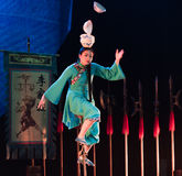 Balancing a stack of bowls on the head-Acrobatic showBaixi Dream Night Royalty Free Stock Photo