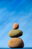 Balancing stones. On a blue background Stock Photo