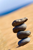 Balancing stones on a beach Stock Images