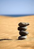 Balancing stones on a beach Royalty Free Stock Photography
