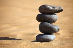 Balancing stones on a beach Royalty Free Stock Image