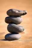Balancing stones on a beach Stock Image