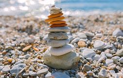 Balancing stones on the beach. Balancing stones on the sanny beach royalty free stock photography