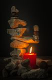 Balancing stones with a candle stock photography