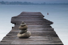 Balancing Stones on a Jetty Royalty Free Stock Images