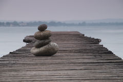Balancing Stones on a Jetty Royalty Free Stock Photos