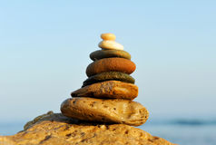 Balancing stones placed on the shore of sea royalty free stock images