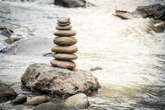 Balancing stones on river rocks. Balancing stones on a river rocks. Stability concept in a turbulence world stock photography