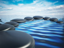 Balancing stones on the sea surface Royalty Free Stock Photos