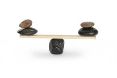 Balancing Stones On Seesaw Royalty Free Stock Photos