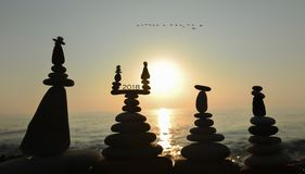 2018 in balancing stones. Zen balancing stones illustrated with 2018 against setting sun Royalty Free Stock Image