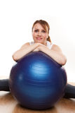 Balancing On Swiss Ball Royalty Free Stock Photography
