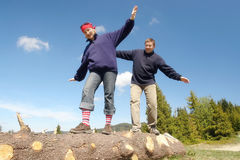 Balancing on wooden log Royalty Free Stock Photo