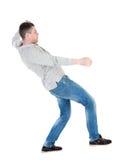 Balancing young man or dodge falling man Royalty Free Stock Photos