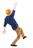 Balancing young man.  or dodge falling man/ worker in constructi. Balancing young man.  or dodge the falling man. worker in construction helmet falls. Rear view Royalty Free Stock Photography