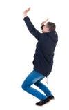 Balancing young man in parka. royalty free stock photos