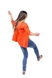 Balancing young woman. Royalty Free Stock Image