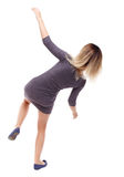 Balancing young woman. royalty free stock photography