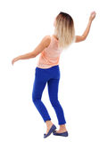 Balancing young woman. Stock Image