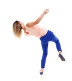 Balancing young woman. Royalty Free Stock Photo