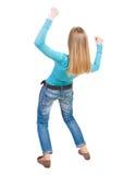 Balancing young woman.  or dodge falling woman Royalty Free Stock Photo