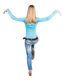 Balancing young woman.  or dodge falling woman Stock Photography