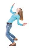 Balancing young woman.  or dodge falling woman Stock Image