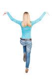 Balancing young woman.  or dodge falling woman Royalty Free Stock Images