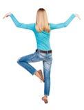 Balancing young woman.  or dodge falling woman Stock Photos