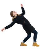 Balancing young woman in parka. Royalty Free Stock Images