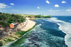 Balangan beach Bali Indonesia / Azure beach with rocky mountains and clear water of Indian ocean at sunny day stock image