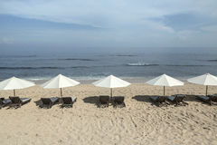 Balangan beach with parasol, Nusa Dua, is one of the most beautiful in Bali, it is called Mars at its bottom is covered with volca Stock Photos