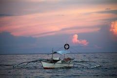 Balangay на заходе солнца Стоковое Изображение