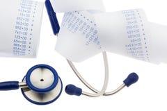 Balanscijfers en stethoscoop Stock Foto
