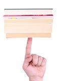 balansera böcker Arkivbild