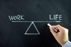 Balanza de la vida del trabajo Fotos de archivo